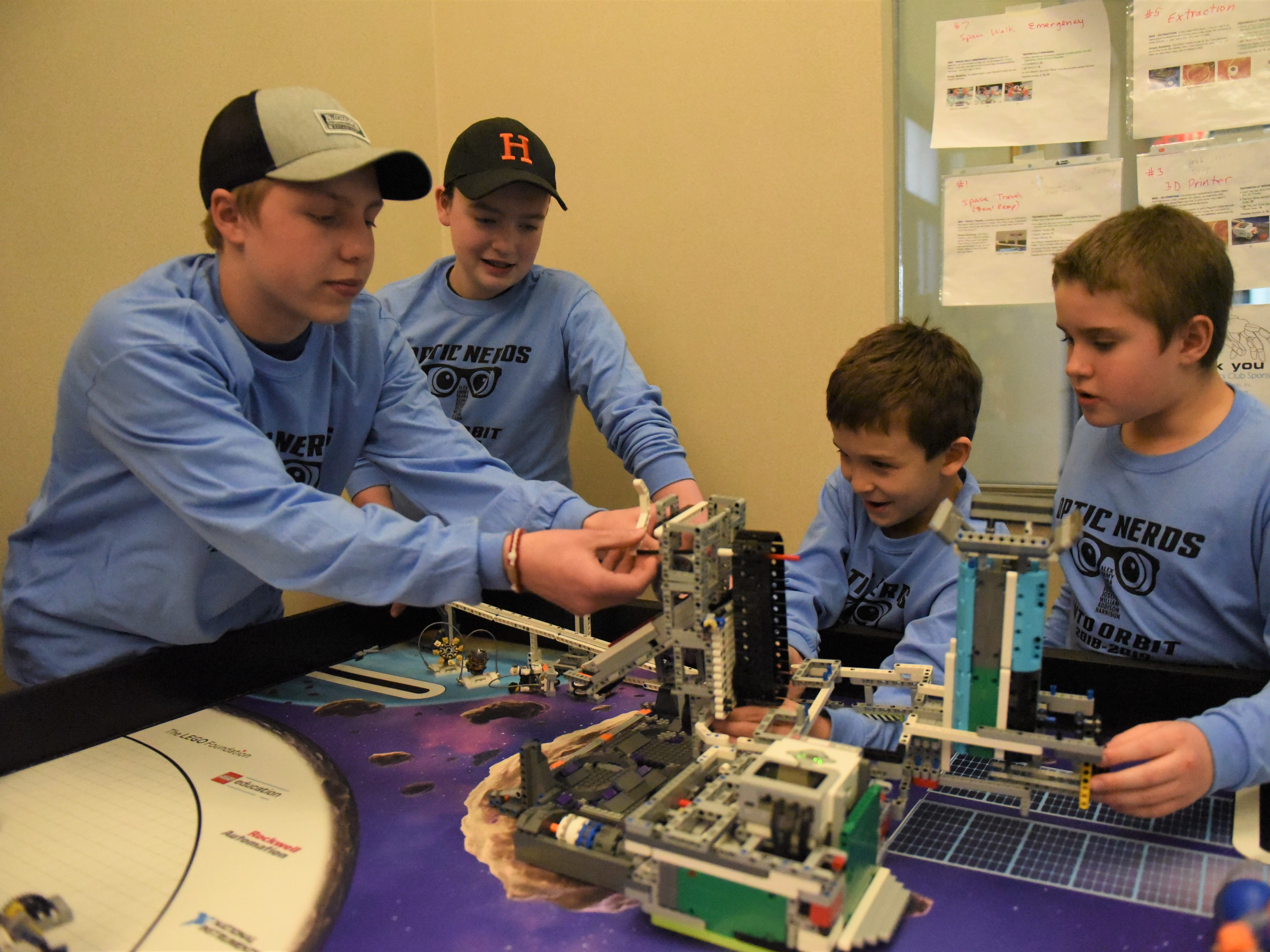 From left, Elijah Morton, 13, Josiah Brower, 13, Harrison Roth, 9, and Joseph McCall, 11, tinker with their robot at a practice before the FIRST LEGO League Competition on Jan. 26. They are four of the members of the Optic Nerds robotics team at the Guthrie Memorial Library.