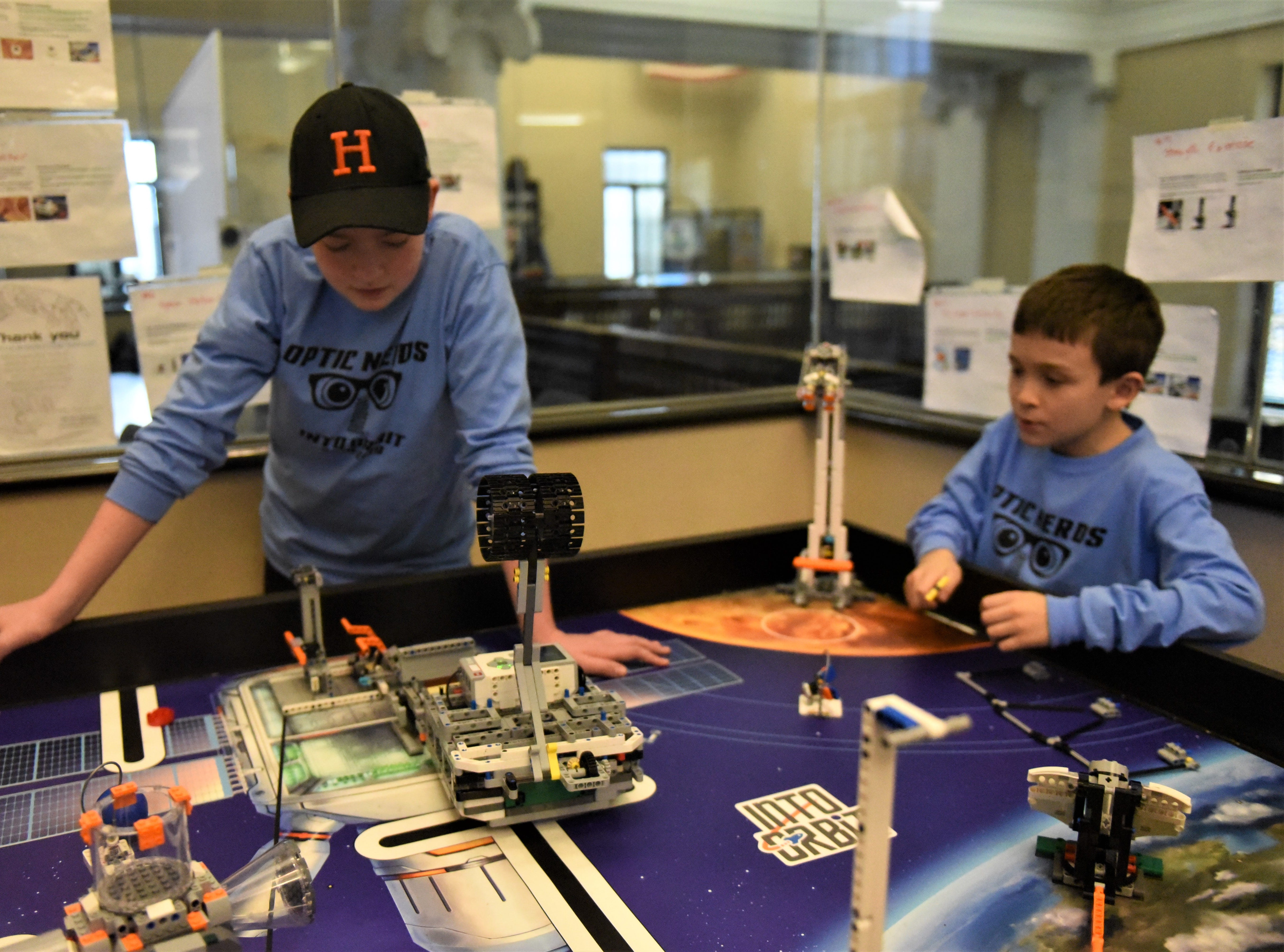 Josiah Brower, 13, left, and Harrison Roth, 9, test a robot before their competition on Jan. 26 at the Penn State Berks Campus.