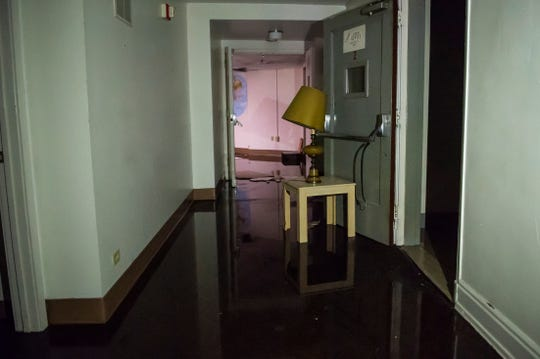 Water fills a hallway on the second floor of the vacant M'Calister Inn at 11 York Street in Hanover Borough on Wednesday, January 23, 2019.
