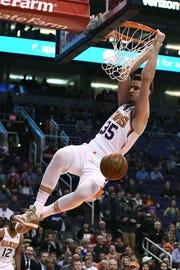 Jan 22, 2019; Phoenix, AZ, USA; Phoenix Suns forward Dragan Bender (35) dunks the ball against the Minnesota Timberwolves in the first half at Talking Stick Resort Arena. Mandatory Credit: Jennifer Stewart-USA TODAY Sports