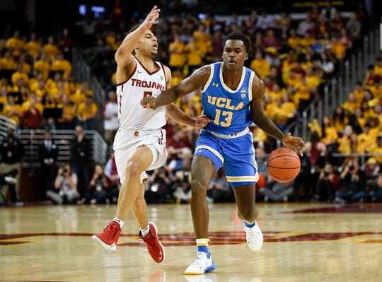 UCLA Bruins guard Kris Wilkes (13) drives the ball while Southern California Trojans guard Derryck Thornton (5) defends during the first half at Galen Center Jan. 19. Kelvin Kuo-USA TODAY Sports
