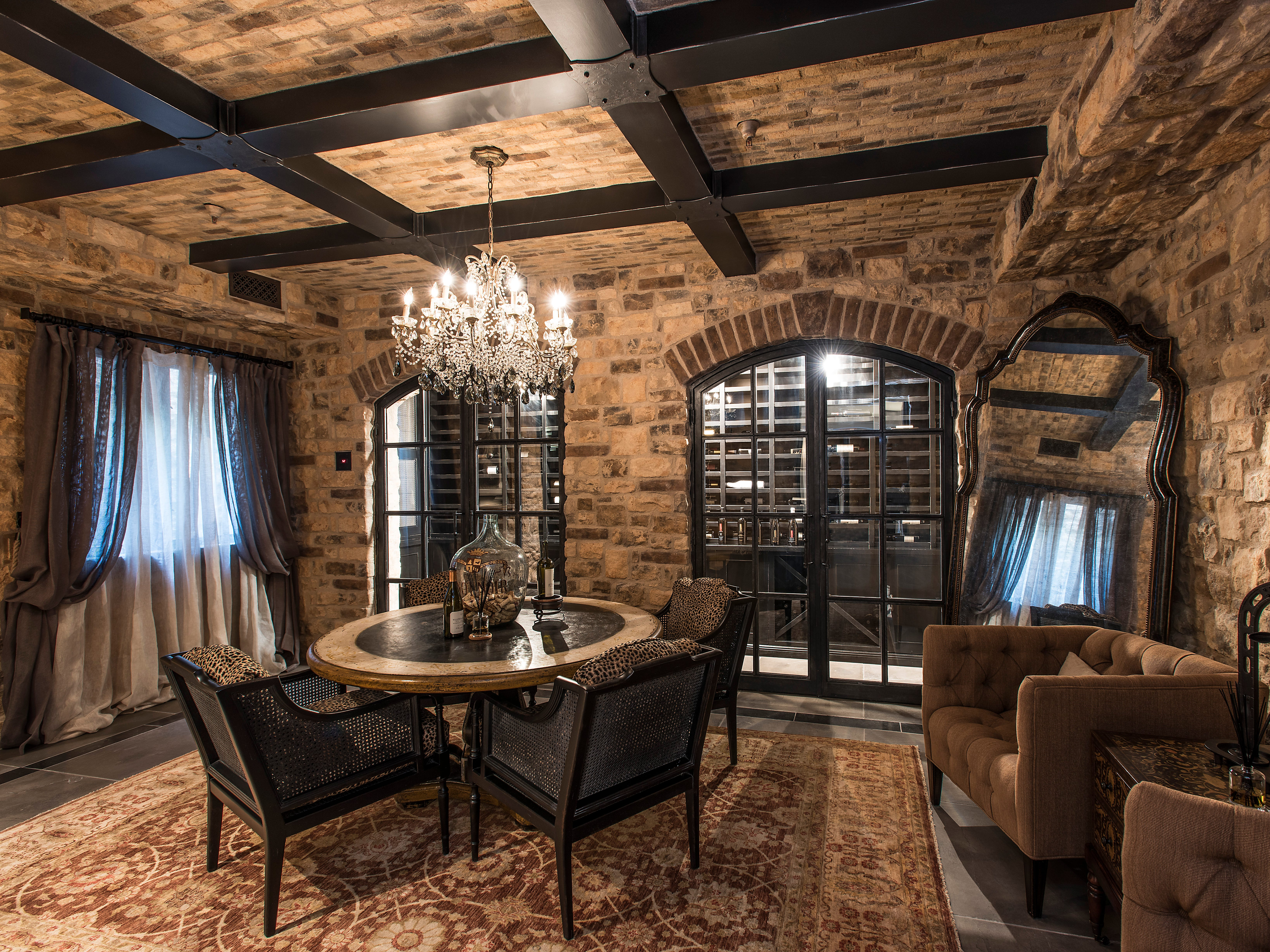 """The 10,000-square-foot home attorney Glen Lerner has listed for sale for $6.99 million comes with a billiards room, workout studio, wine cellar and home theater. The """"resort-style"""" mansion, built in 2009, also has five bedrooms, seven bathrooms, a guest casita and a four-car garage. Look for """"multiple fire features"""" outside near the pool and spa."""