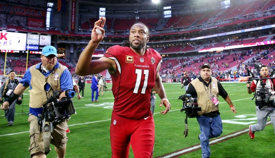 Cardinals receiver Larry Fitzgerald waves to the fans at State Farm Stadium  after a 31-9 loss to the Rams on Dec. 23.