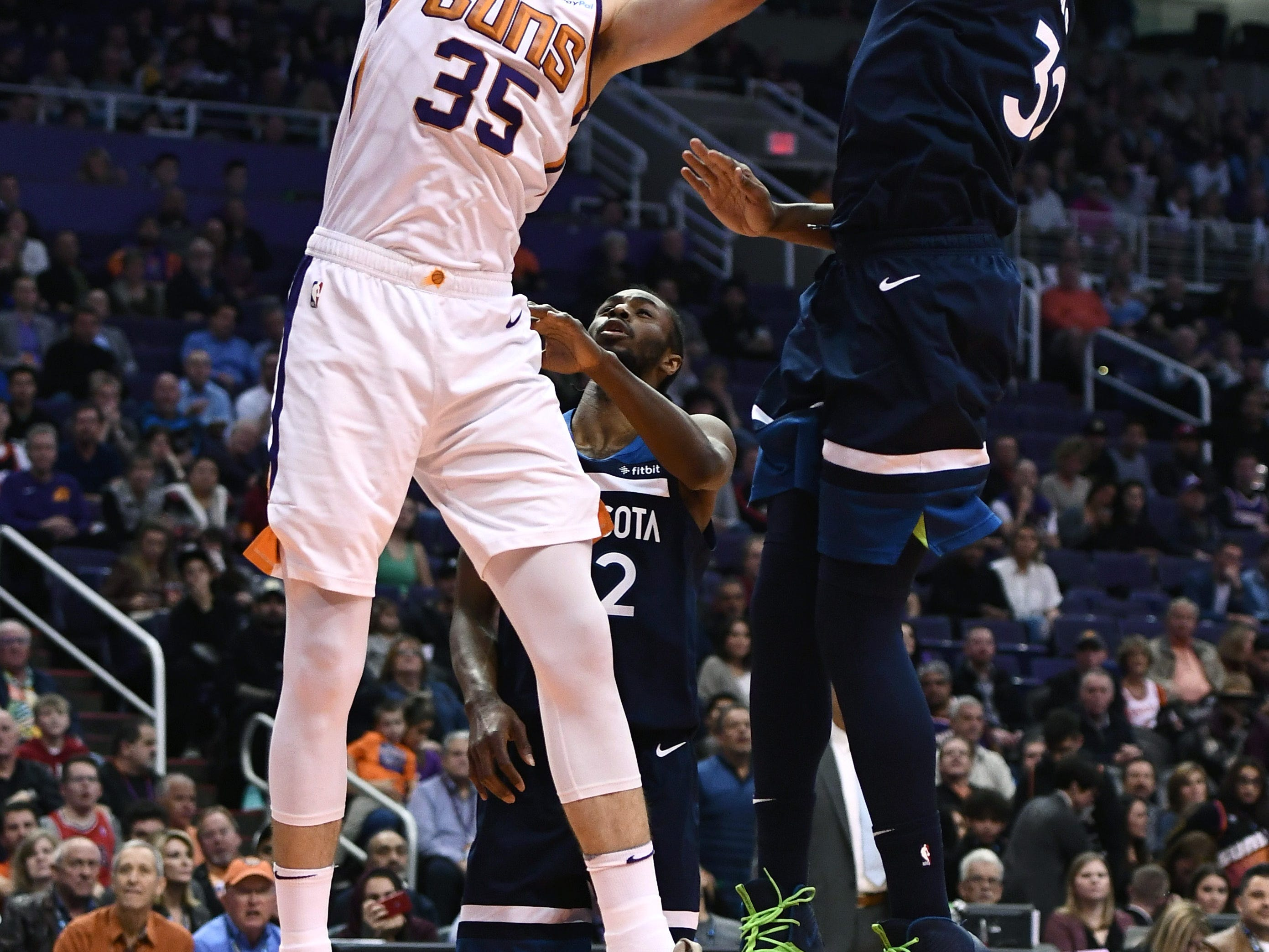 Jan 22, 2019; Phoenix, AZ, USA; Phoenix Suns forward Dragan Bender (35) dunks the ball against Minnesota Timberwolves center Karl-Anthony Towns (32) in the first half at Talking Stick Resort Arena. Mandatory Credit: Jennifer Stewart-USA TODAY Sports