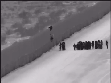 Video shows migrant families using ladder to scale Arizona border fence