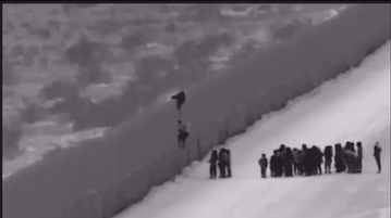 A video released by Customs and Border Protection shows a group of migrants scaling the border fence near Yuma with the help of smugglers using a ladder.