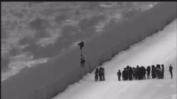 Video shows migrant families using ladder to scale border fence near Yuma