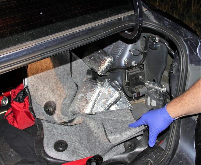 12 pounds of heroin found inside blue sedan trunk liner Wednesday night.