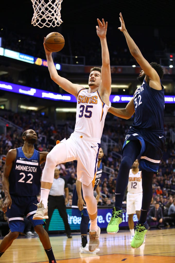 Phoenix Suns forward Dragan Bender drives to the basket and scores against the Minnesota Timberwolves in the first half on Jan. 22 at Talking Stick Resort Arena.