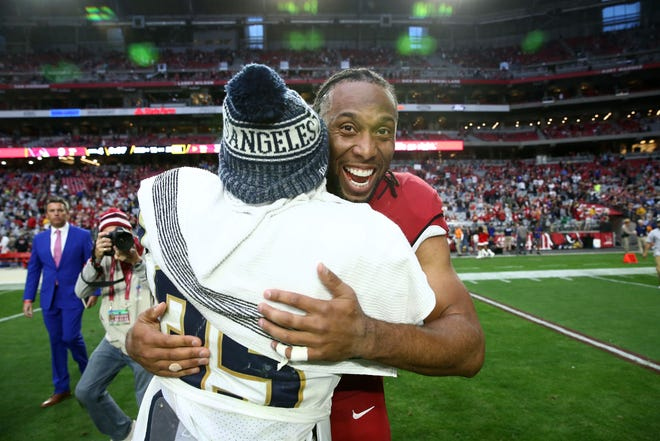 Larry Fitzgerald gives Rams running back C.J. Anderson a hug after a Cardinals loss to L.A. 31-9 on Dec. 23 at State Farm Field.