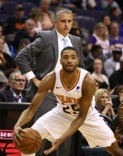 Mikal Bridges holds the ball as his coach Igor Kokoskov looks on during a game against the Timberwolves on Jan. 22.