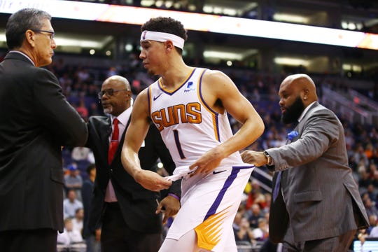 Phoenix Suns guard Devin Booker runs for the locker room after being ejected from the game following a confrontation with Minnesota Timberwolves center Gorgui Dieng in the second half on Jan. 22 at Talking Stick Resort Arena.