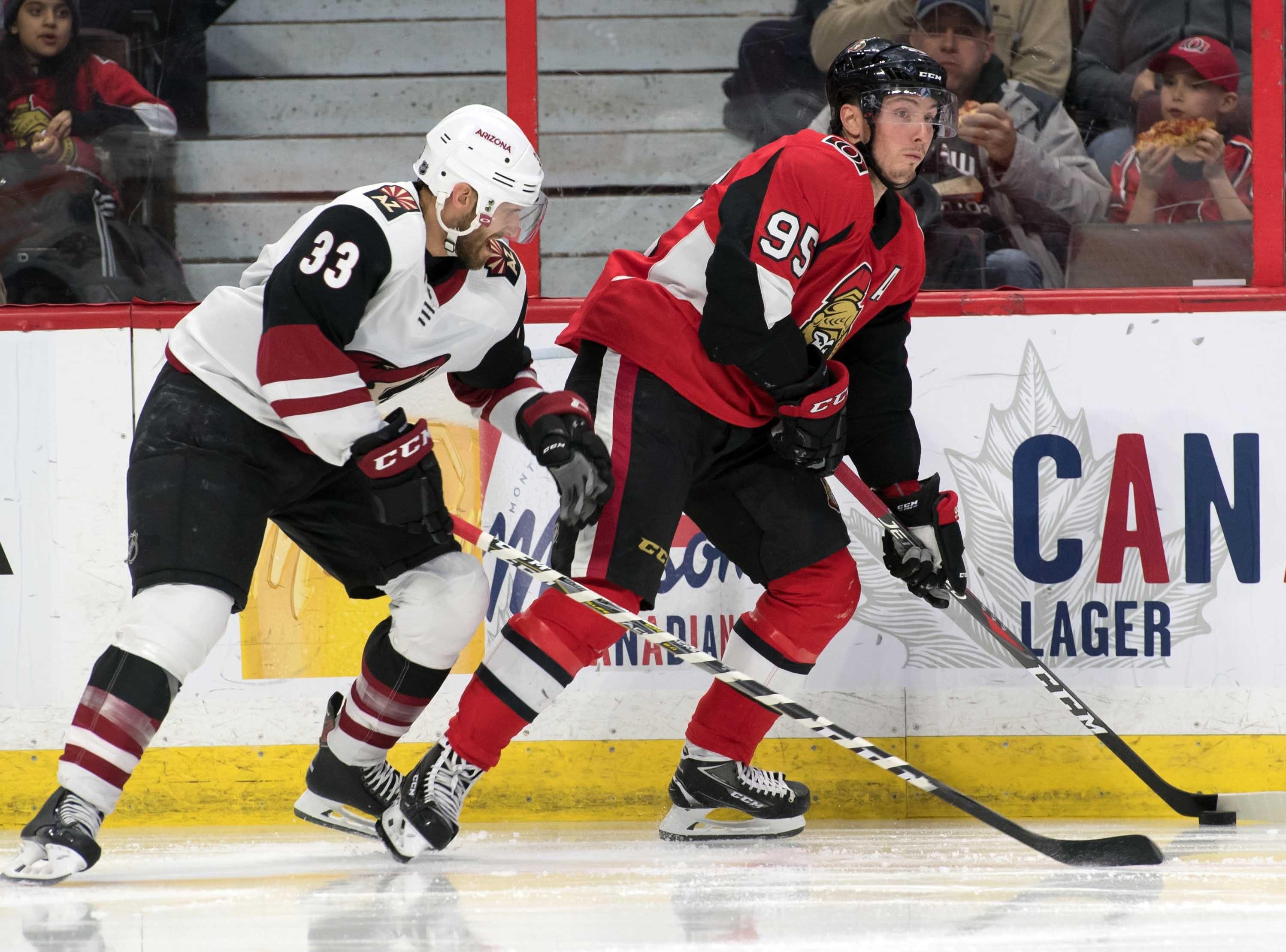 Jan 22, 2019; Ottawa, Ontario, CAN; Arizona Coyotes defenseman Alex Goligoski (33) chases Ottawa Senators [center Matt Duchene (95) in the second period at the Canadian Tire Centre. Mandatory Credit: Marc DesRosiers-USA TODAY Sports