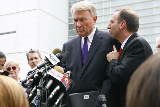 Attorney John Bouma (center) speaks to the press outside the Sandra Day O'Connor U.S. Courthouse on July 22, 2010.