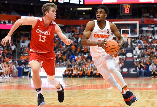 Syracuse Orange forward Oshae Brissett (11) drives to the basket against the defense of Cornell Big Red forward Stone Gettings (13) during the second half at the Carrier Dome Nov. 10, 2017.  Rich Barnes-USA TODAY Sports