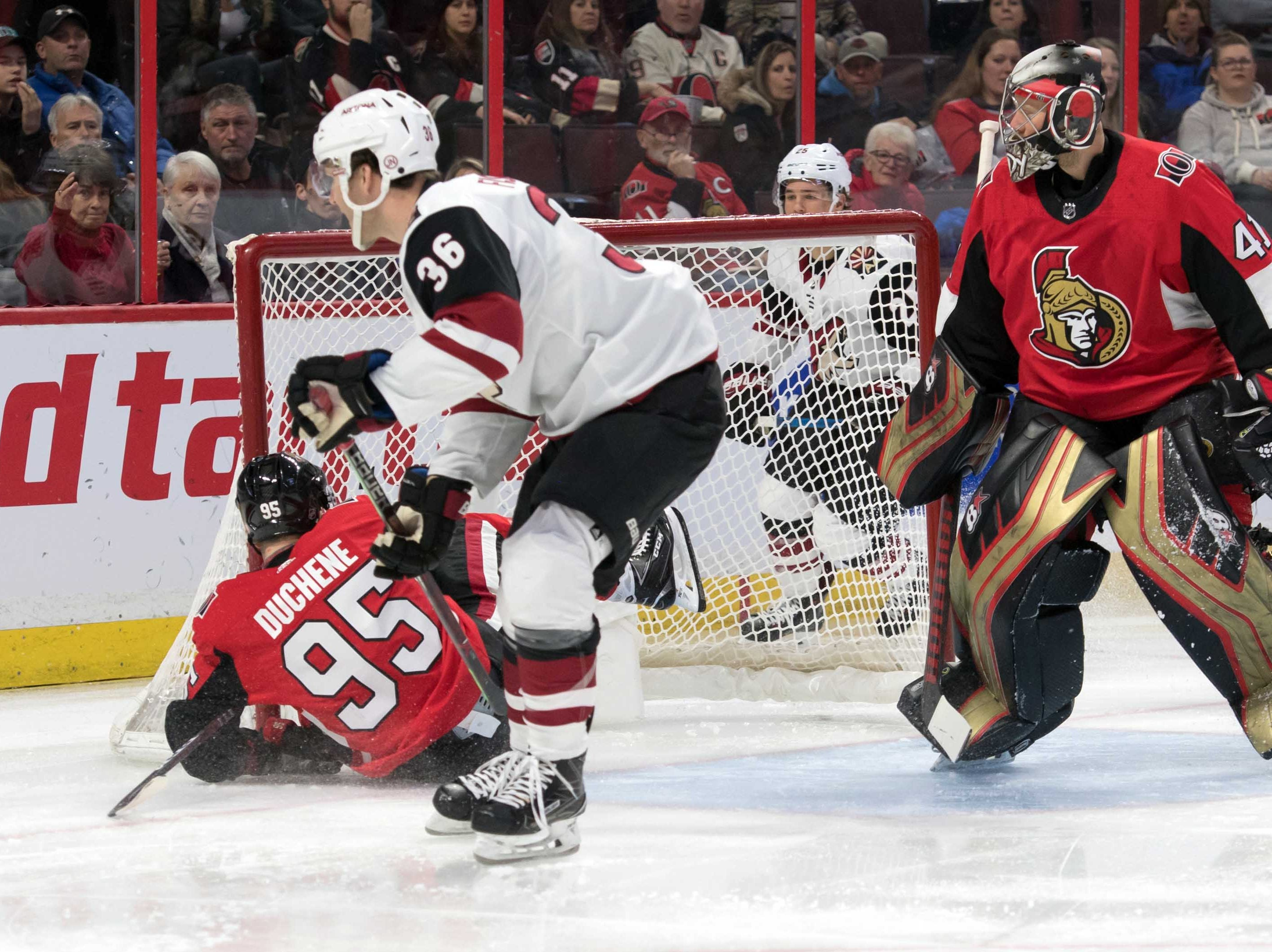 Jan 22, 2019; Ottawa, Ontario, CAN; Ottawa Senators center Matt Duchene (95) is driven into the net by Arizona Coyotes right wing Christian Fischer (36) in the first period at the Canadian Tire Centre. Mandatory Credit: Marc DesRosiers-USA TODAY Sports