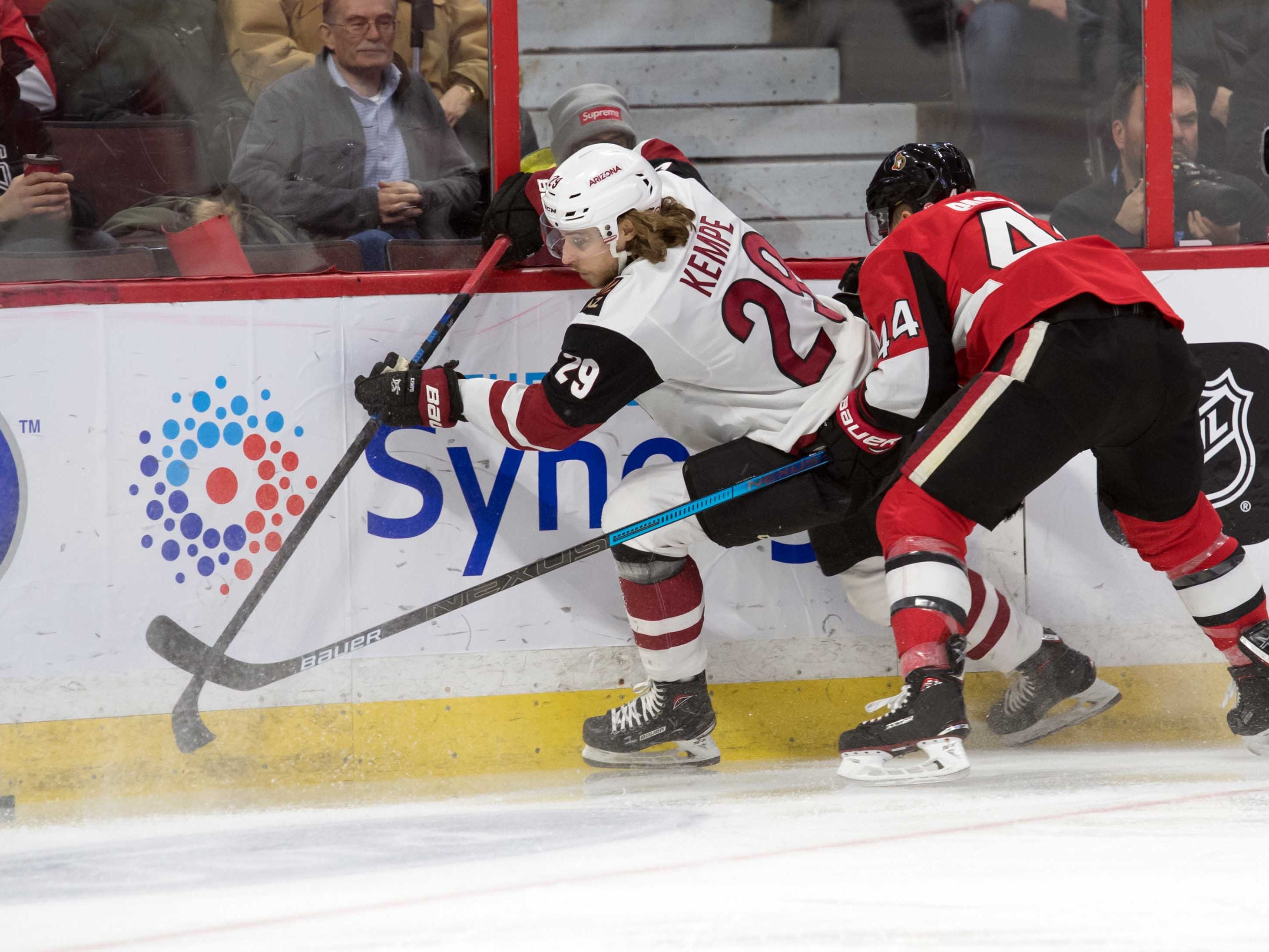 Jan 22, 2019; Ottawa, Ontario, CAN; Arizona Coyotes right wing Mario Kempe (29) battles with Ottawa Senators center Jean-Gabriel Pageau (44) in the first period at the Canadian Tire Centre. Mandatory Credit: Marc DesRosiers-USA TODAY Sports