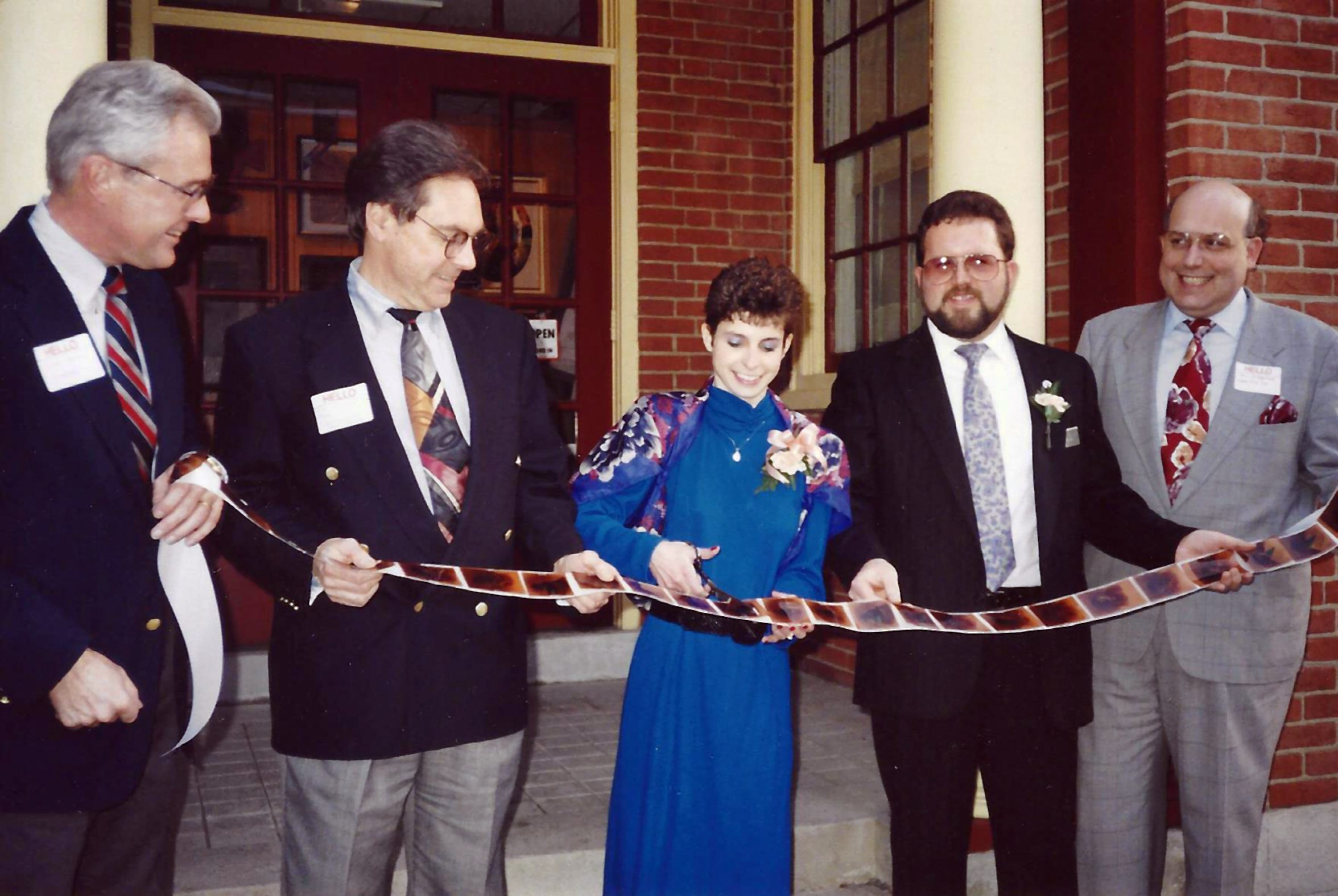 Robert Howard (second from right) holds a ribbon cutting as he became owner of Howard Studios in 1992.