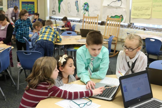 Tasked with the role of teacher, Kyle Abernathy, a third grade student at Bataan Intermediate School, leads students through a lesson on Wednesday.