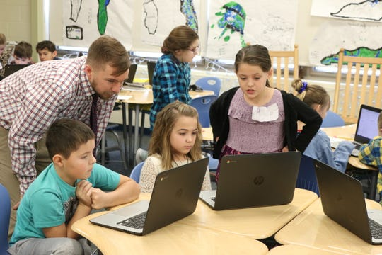 Layla Garcia, right, a third grade student at Bataan Intermediate School, wants to be a teacher when she gets older and got the chance to try it as part of a class project on Wednesday.