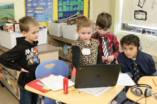 McKenzie Pavlick, a third grade student at Bataan Intermediate School, walks her peers through a lesson as part of a project that had students stepping into the role of teacher.
