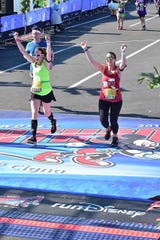 Kim Caruso and Fishkill's Jessica Imperiale run as part of completing the Dopey Challenge last weekend in Disney World.