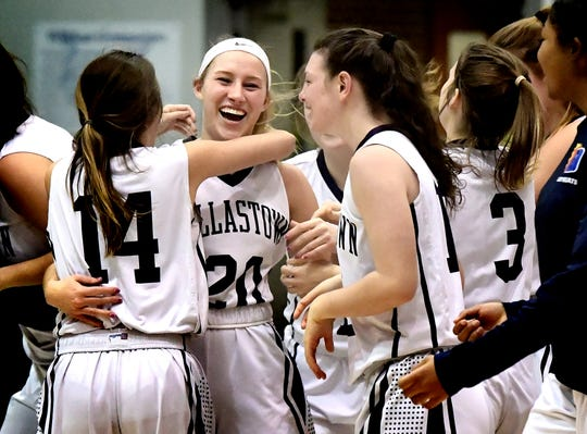 Dallastown's Lily Jamison is swarmed by teammates after she hit a three-pointer at the buzzer to beat visiting South Western in triple overtime 38-35 Tuesday, Jan. 22, 2019. Bill Kalina photo