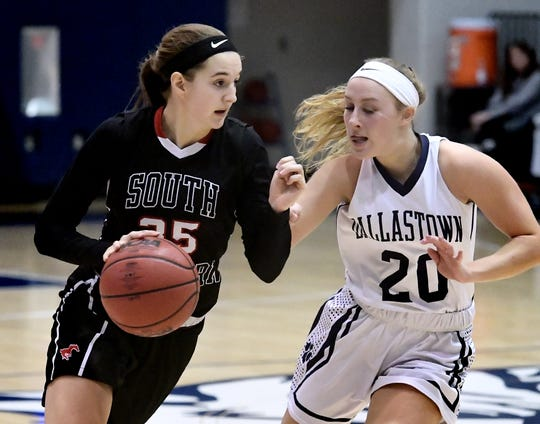 South Western's Taylor Geiman drives with Dallastown's Lily Jamison defending during action at Dallastown Tuesday, Jan. 22, 2019. Dallastown won 38-35 in triple overtime on a buzzer-beater by Jamison. Bill Kalina photo
