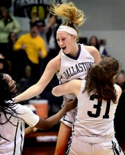 Dallastown's Lily Jamison, center, is swarmed by teammates D'Shantae Edwards, left, and Samantha Miller after Jamison hit a three-pointer at the buzzer to beat visiting South Western in triple overtime 38-35 Tuesday, Jan. 22, 2019. Bill Kalina photo