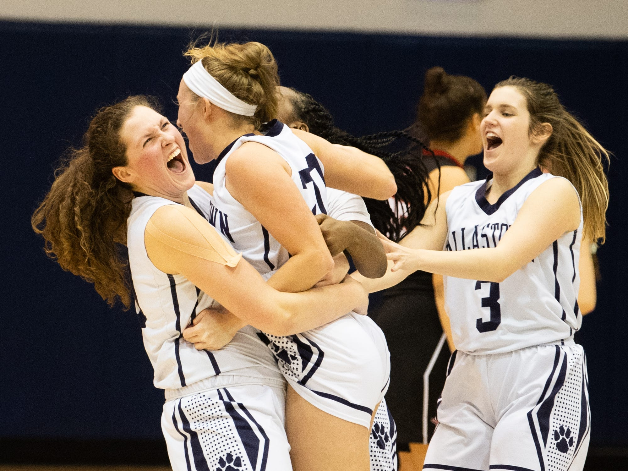Dallastown players rush the floor after Lily Jamison (20) hits a game winning three-pointer solidifying a their triple overtime victory over South Western, Tuesday, January 22, 2019. The Wildcats defeated the Mustangs 38-35.