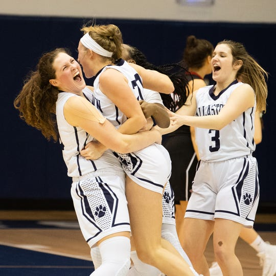 Dallastown players rush the floor after Lily Jamison (20) hit a game-winning three-pointer in their triple overtime victory over South Western on Jan. 22. The Wildcats will play for their first-ever district title on Friday.
