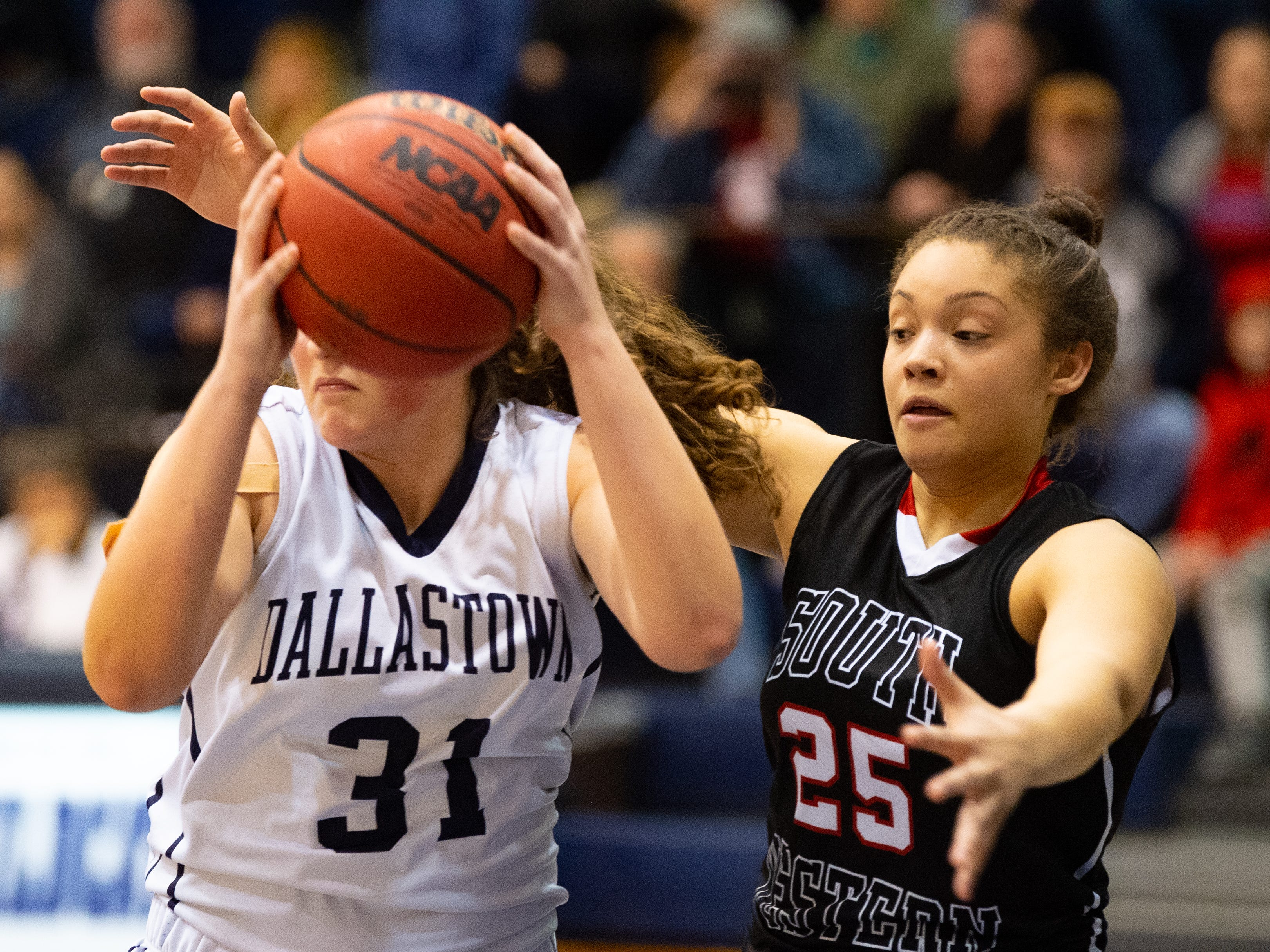 South Western's Ali St. Rose (25) guards Samantha Miller of Dallastown (31) during the YAIAA girls' basketball game, Tuesday, January 22, 2019. The Wildcats defeated the Mustangs 38-35.