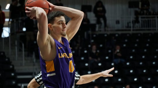 Antonio Rizzuto followed his cousins Jon and Jake Iati to the University of Albany to play basketball. Rizzuto is starting as a freshman and Jon is one of his coaches.