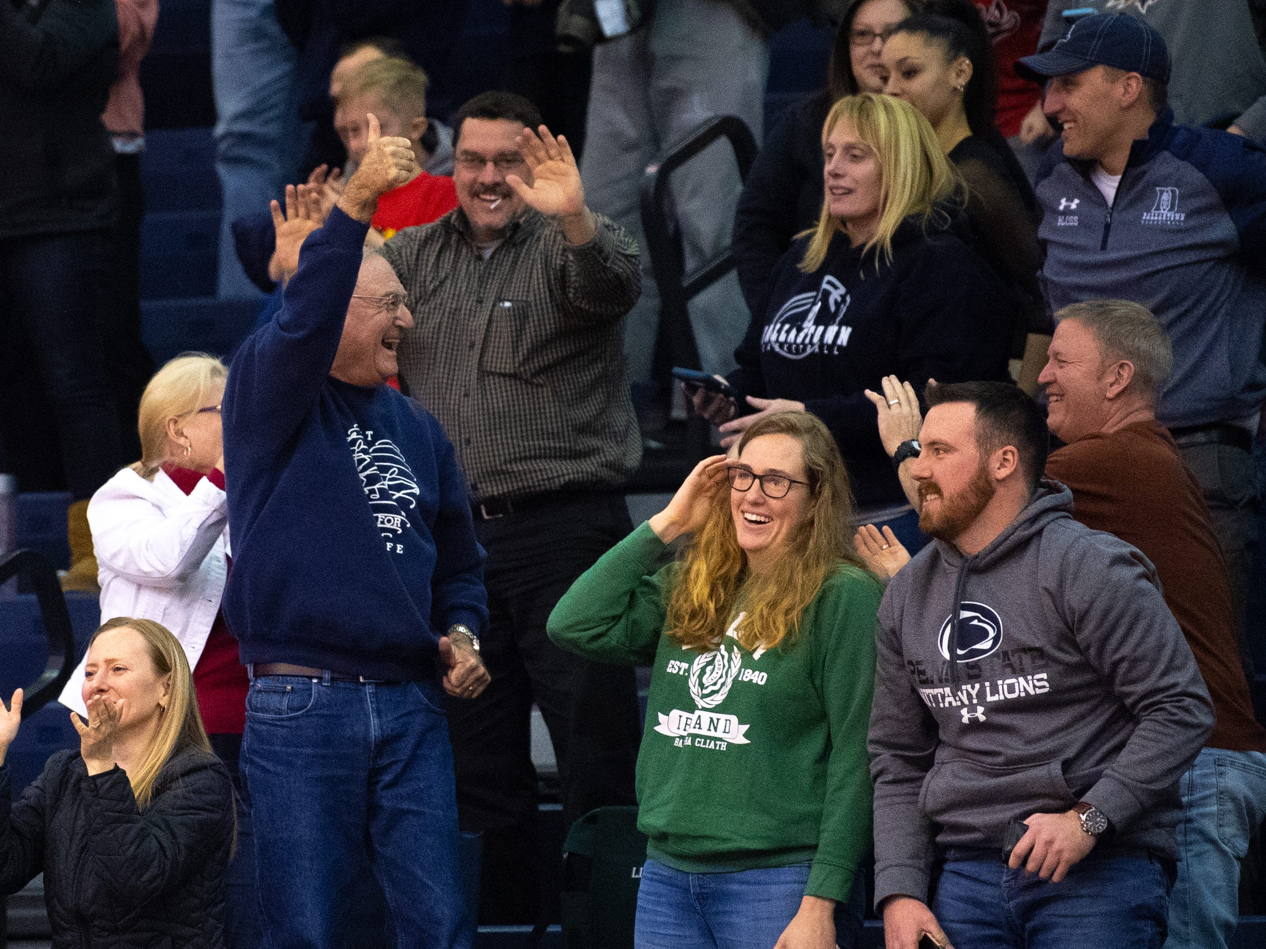 Dallastown parents celebrate a nail biting victory after the YAIAA girls' basketball game between Dallastown and South Western, Tuesday, January 22, 2019. The Wildcats defeated the Mustangs 38-35.