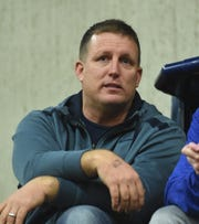 Jon Haskins, Reno High's new football coach, watches the Reno boys basketball game at Reed on Tuesday.