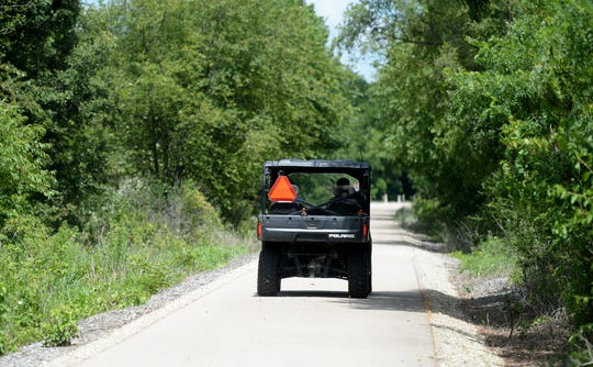 An off-road vehicle is seen on the Cardinal Greenway in Wayne County.