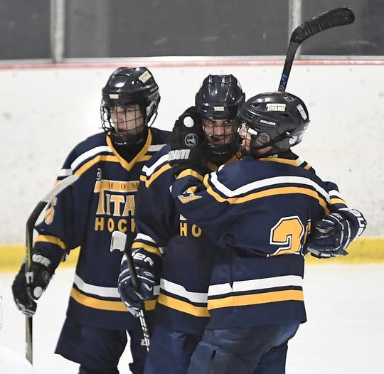 Webster Thomas' Spencer Nuccitelli, center, celebrates his first goal with Cullen Hennessy, left, and Zack Wolfe during a regular season game against Chuchville-Chili played at the Scottsville Ice Arena, Tuesday, Jan. 22, 2019. Webster Thomas beat Chuchville-Chili 4-1.