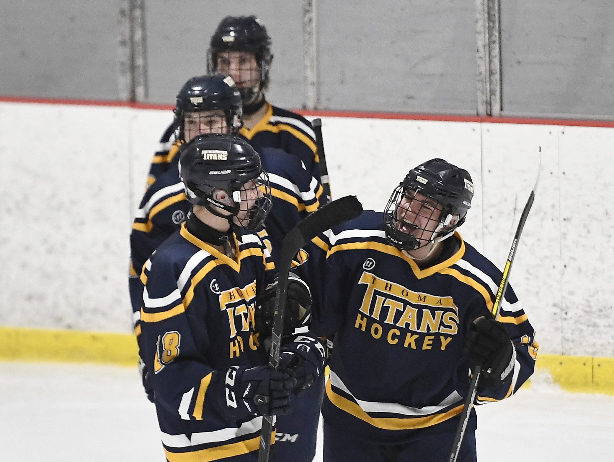 Webster Thomas' Tommy Ammon, right, celebrates his goal with Liam Mayer during a regular season game against Chuchville-Chili played at the Scottsville Ice Arena, Tuesday, Jan. 22, 2019. Webster Thomas beat Chuchville-Chili 4-1.