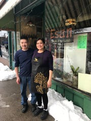 Boun and Kim Douangratdy stand outside their Thai restaurant.
