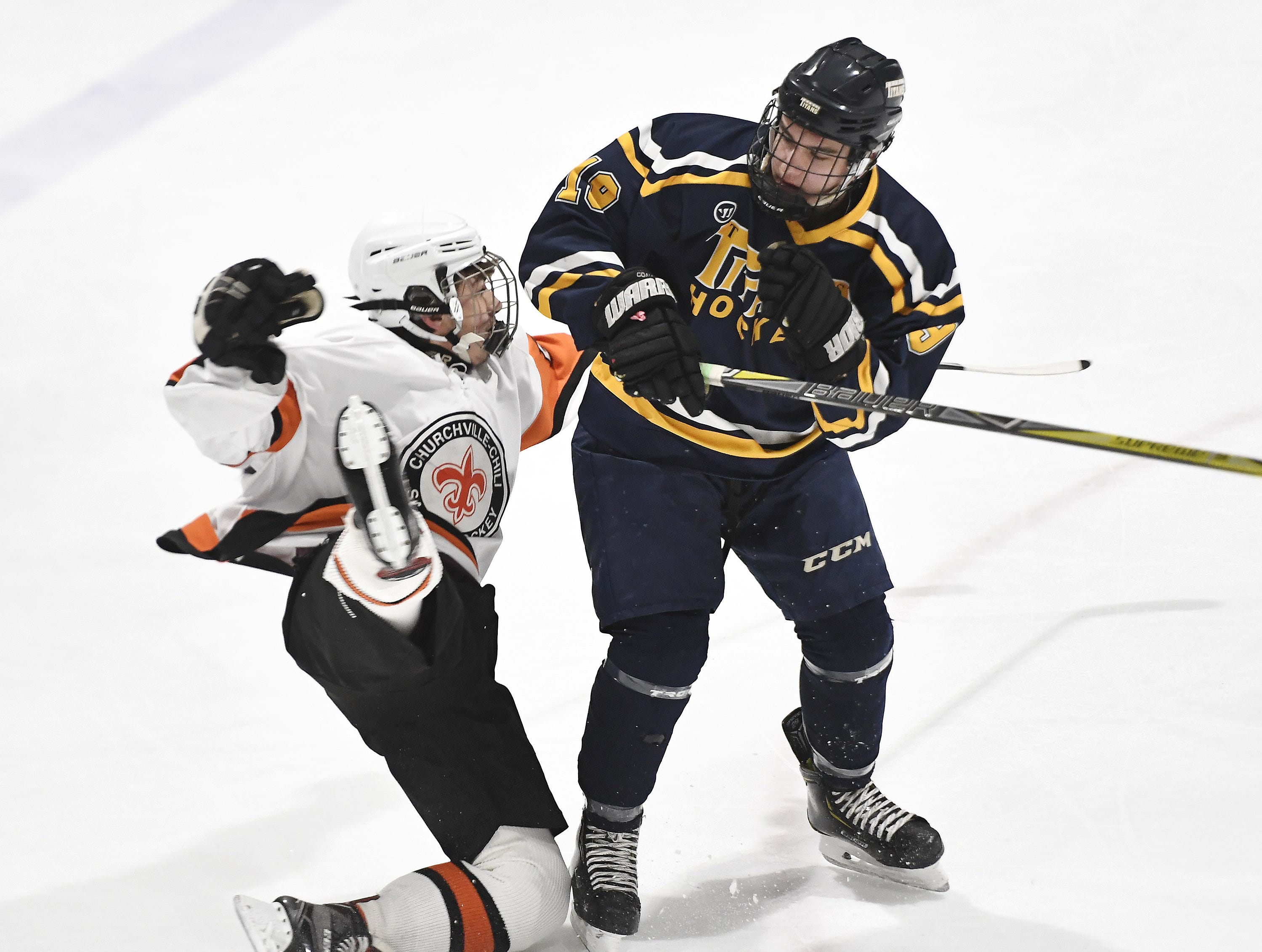 Webster Thomas' Tommy Ammon, right, checks Churchville-Chili's Colin Hess during a regular season game played at the Scottsville Ice Arena, Tuesday, Jan. 22, 2019. Webster Thomas beat Chuchville-Chili 4-1.