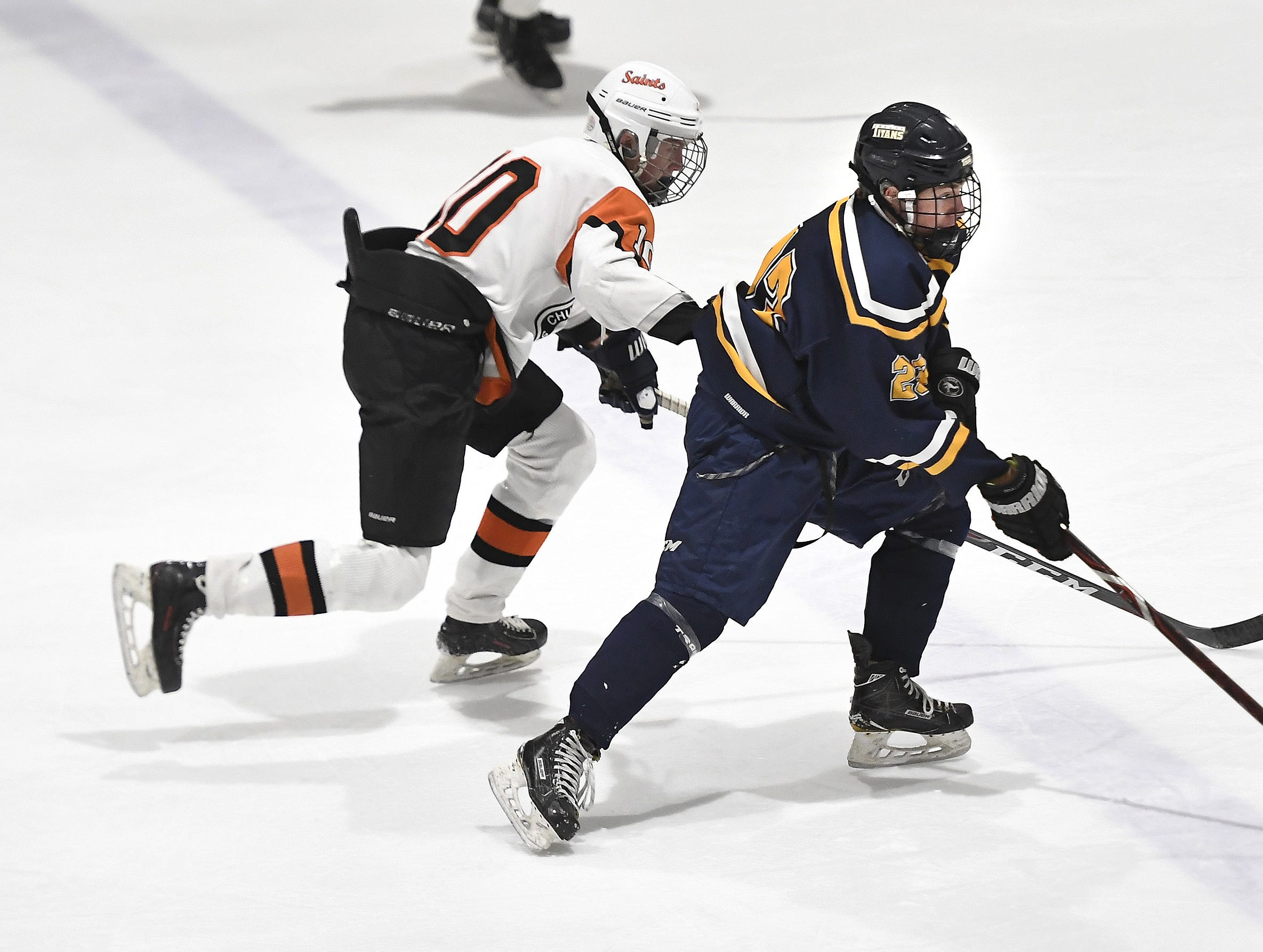Webster Thomas' Reed Currie, right, is defended by Churchville-Chili's Keegan Metcalfe during a regular season game played at the Scottsville Ice Arena, Tuesday, Jan. 22, 2019. Webster Thomas beat Chuchville-Chili 4-1.