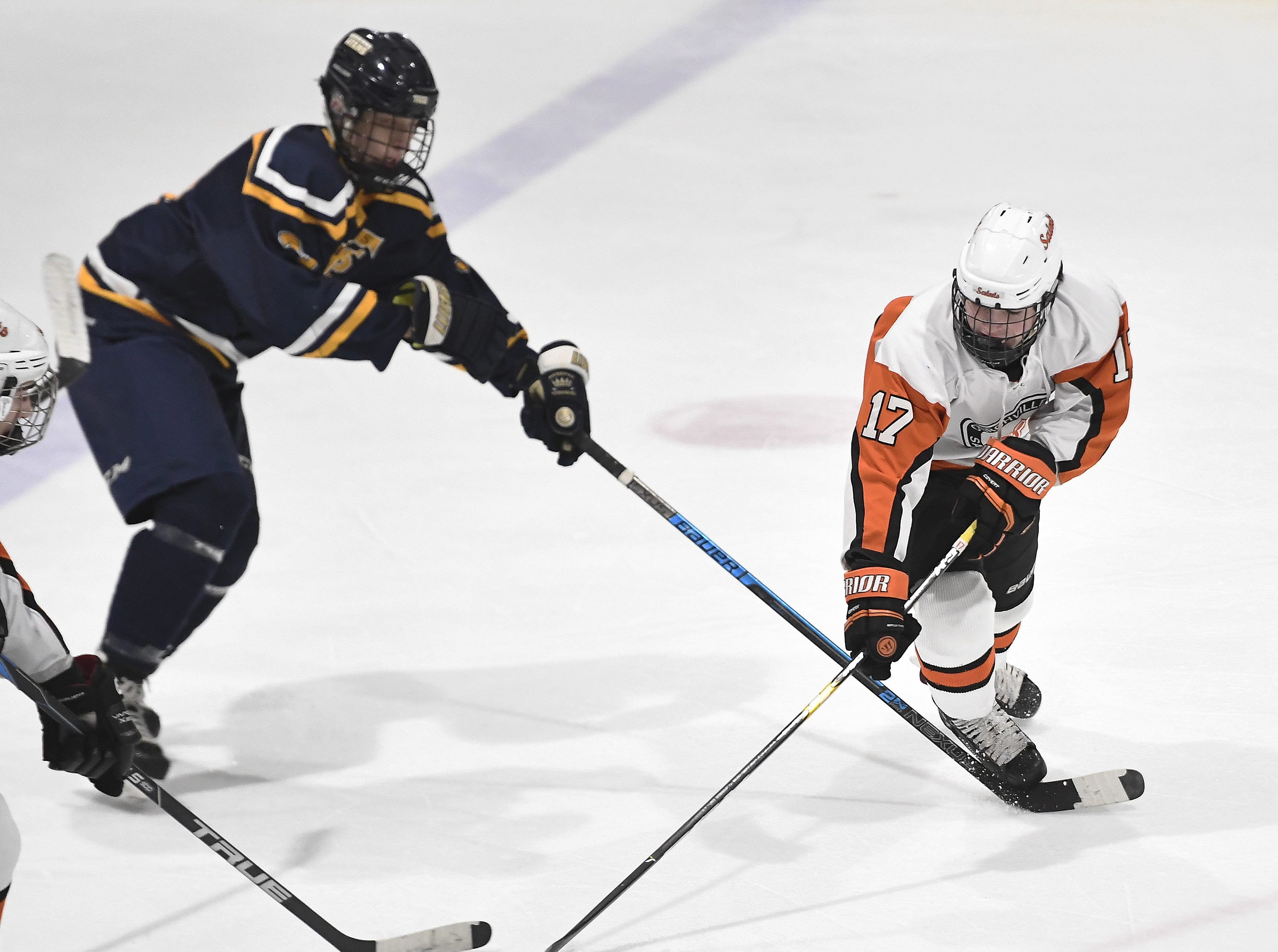 Churchville-Chili's Max Williams, right, is tripped up by Webster Thomas' Teagan Spang during a regular season game played at the Scottsville Ice Arena, Tuesday, Jan. 22, 2019. Webster Thomas beat Chuchville-Chili 4-1.