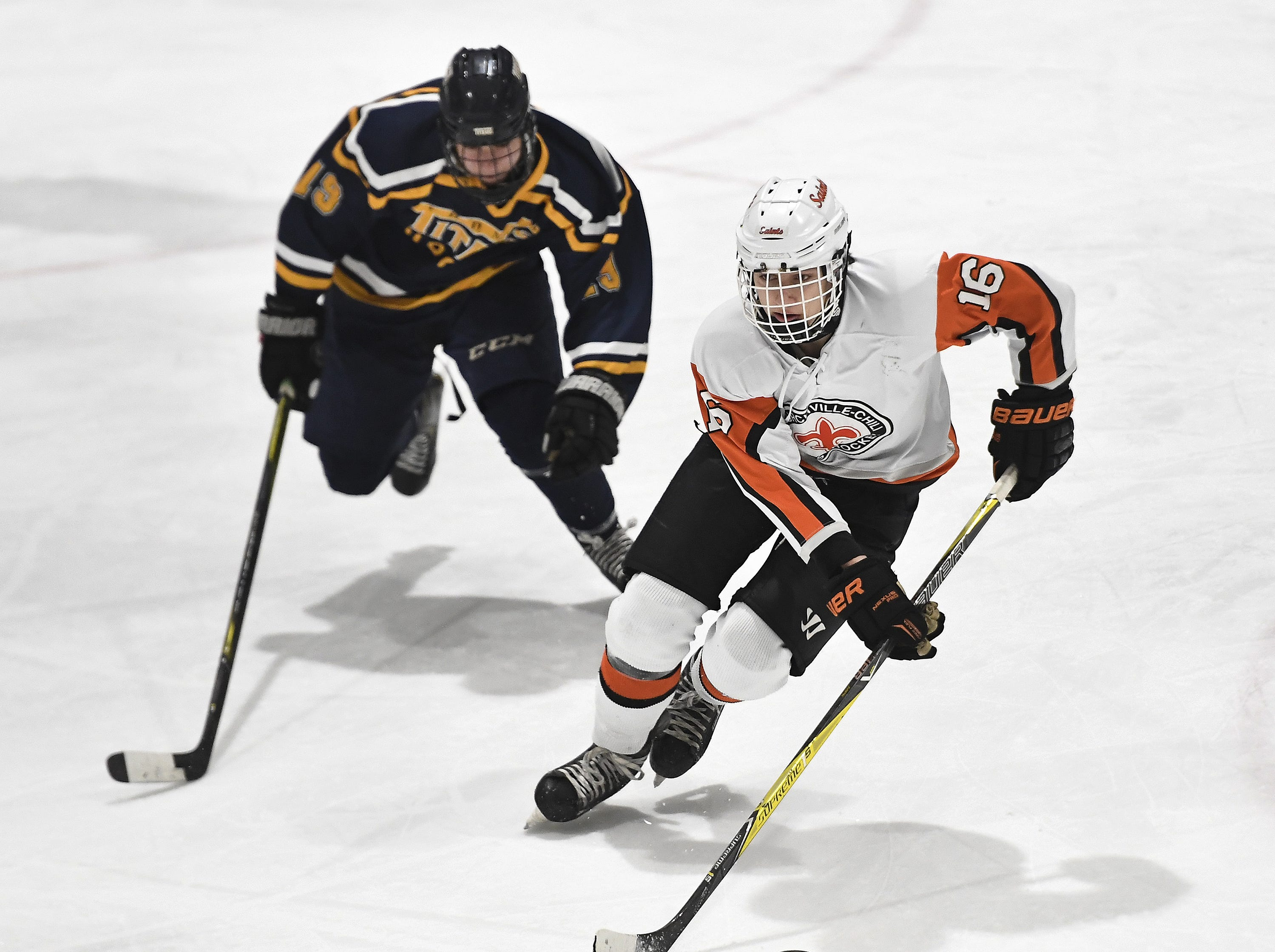 Churchville-Chili's Luke Molnar, right, skates the puck away from Webster Thomas' Tommy Ammon during a regular season game played at the Scottsville Ice Arena, Tuesday, Jan. 22, 2019. Webster Thomas beat Chuchville-Chili 4-1.