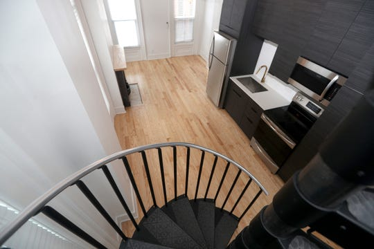 The larger one-bedroom apartment has a spiral staircase.
