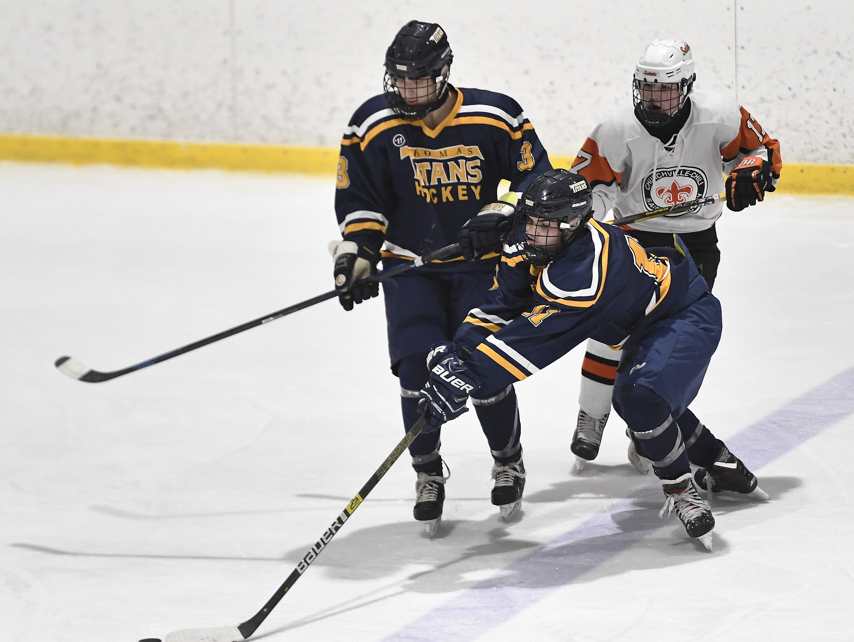 Webster Thomas' Spencer Nuccitelli reaches around Teagan Spang to keep the puck in the zone during a regular season game against Chuchville-Chili played at the Scottsville Ice Arena, Tuesday, Jan. 22, 2019. Webster Thomas beat Chuchville-Chili 4-1.
