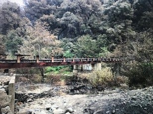 The burnt bridge to Janet Landles' home west of Redding. The bridge and house burned in the Carr Fire.