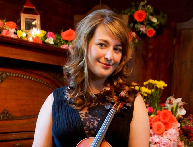 Violinist Rachel Patrick performs with the Trinity Alps Chamber Music Festival at the 2019 Cultural Cruise at Old City Hall in Redding.