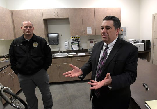 Lebanon Police chief Frank Stevenson, left,  and Linn County District Attorney Doug Marteeny talk about evidence that the crime lab has not tested.