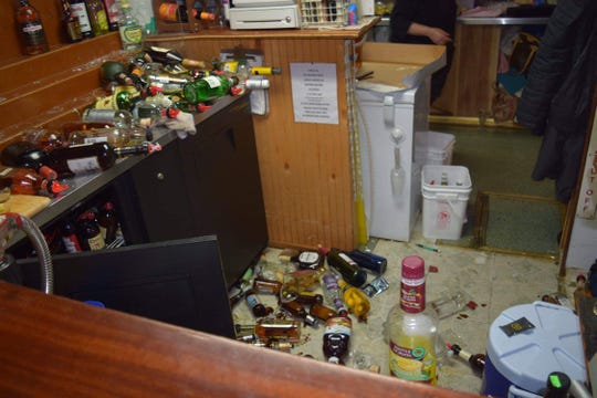 Alcohol bottles were knocked over upon impact, shattering as they hit the floor of the top deck of the Willamette Queen on Saturday, Jan. 19, 2019.