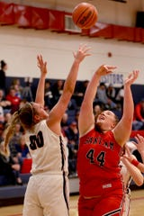 Kennedy's Sophia Carley (00) and Santiam's McKenzie Dodge (44) both go up for a rebound in the Santiam vs. Kennedy girls basketball game at Kennedy High School in Mt. Angel on Tuesday, Jan. 22, 2019. Kennedy won the gam 62-49.